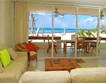 living room with pull-out sofas, beach/ocean view, stereo, satelite and TV